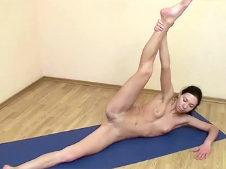 Nude yoga exercises on the yoga mat