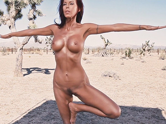 Nude yoga lesson in a desert