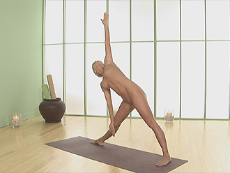 Hot nude yoga girl in triangle yoga pose