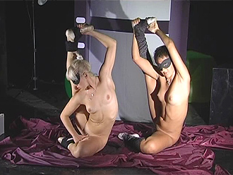 Girl-on-girl naked yoga performance