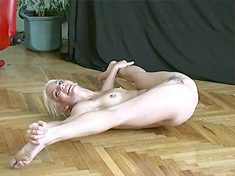 Flexible naked girl in exciting nude yoga show