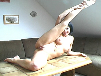 Nude yoga exercises on a coffee table