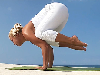 Sexy yoga guru in white yoga pants