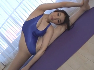 Asian hot yoga girl in shiny blue leotards doing naked yoga workouts