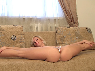 Nude yoga split on the couch