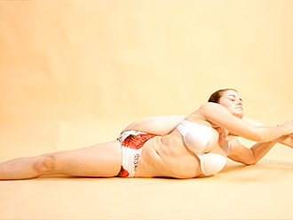 Busty gymnast in sexy yoga video