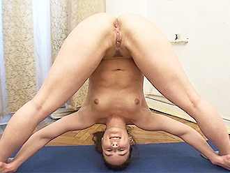 Nude gymnast does naked yoga exercises