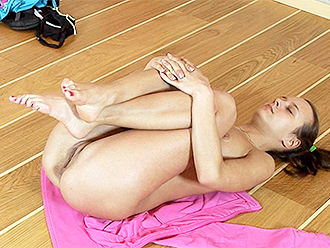 Sexy gymnast does nude yoga on the floor