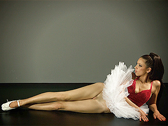 Sexy ballet girl with passionate eyes poses in her close fit clothes