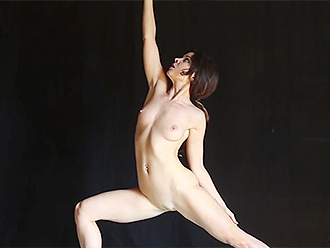 Flexible nude girl performs naked yoga exercises
