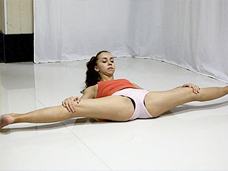 Sexy gymnast does incredible hot yoga exercises