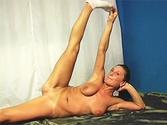Busty amateur girl does naked yoga exercises