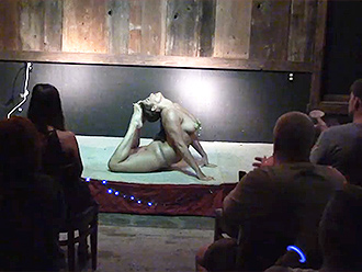 Nearly nude yoga performance