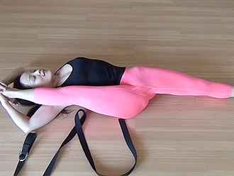 Hot Asian gymnast does exercises in sexy yoga video