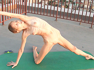 Super skinny gymnast in outdoor public naked yoga video