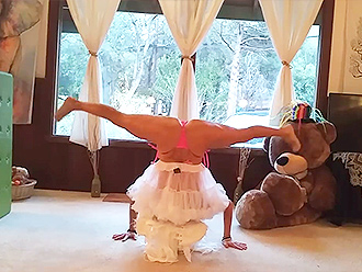 Mature gymnast does nearly nude yoga exercises