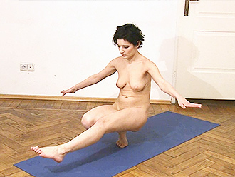Amateur gymnast with tattoo does nude yoga exercises