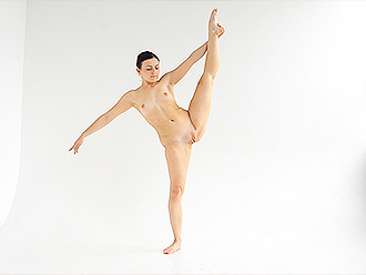 Nude ballerina dancing and posing