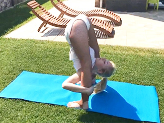 Super flexible girl does outdoor sexy yoga exercises