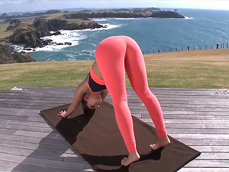 Girl in sexy yoga pants does stretching exercises outdoors in new hot yoga video