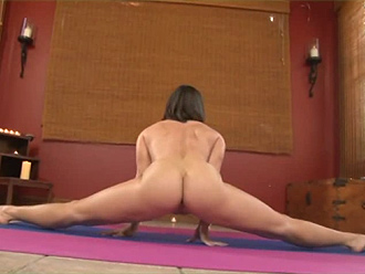 Shapely brunette stretching her legs in naked yoga workouts