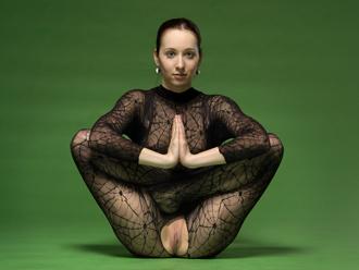 Hot nude yoga teacher Nataly in torn fishnet bodysuit
