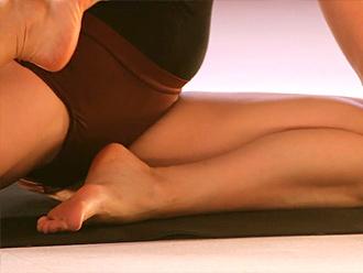 Hot yoga teacher in sexy bodysuit