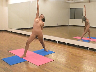 Hot nude yoga in a ballet training room