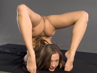 Naked yoga exercises with nude gymnast