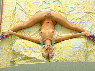Naked gymnast in hottest nude yoga poses on the bed
