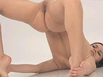 Nude gymnast in naked yoga performance