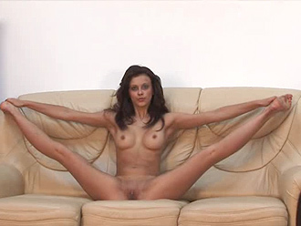 Hot nude yoga poses on a leather couch
