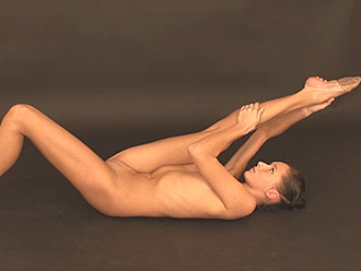 Flexible nude gymnast warms up on video