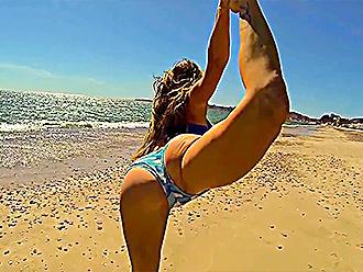 Hot yoga girl at the beach