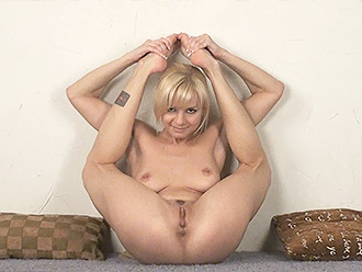 Naked contortionist in nude yoga workout