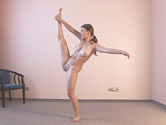 Naked gymnast does nude yoga exercises at home