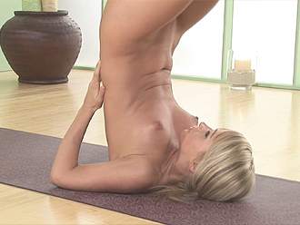 Nude yoga shoulder stand with plow pose