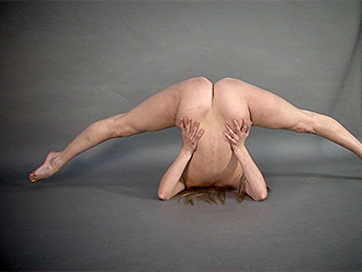 Nude gymnast does nude yoga in the studio