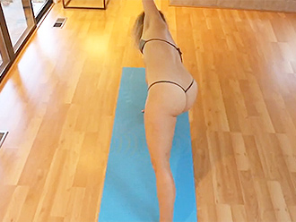 Hot yoga girl in transparent bikini