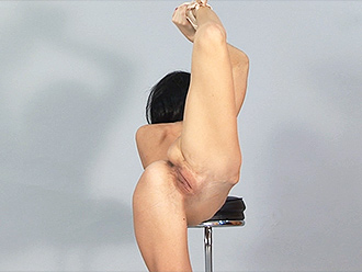 Naked ballet dancer does nude yoga in the studio