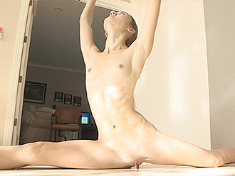 Naked ballerina warms up