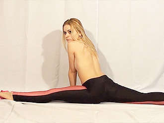 Sexy Nadin in topless yoga video