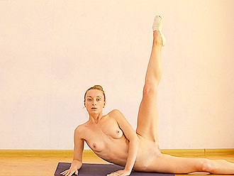 Nude ballet dancer does naked yoga exercises
