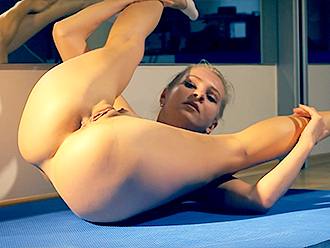 Nude gymnast in naked yoga video
