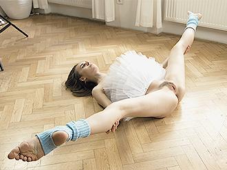 Naked yoga dancer in tutu