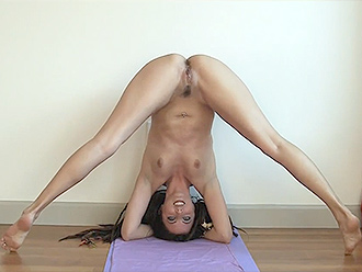 Sexy gymnast does nude yoga exercises