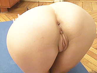 Naked flexible girl does nude yoga exercises at home