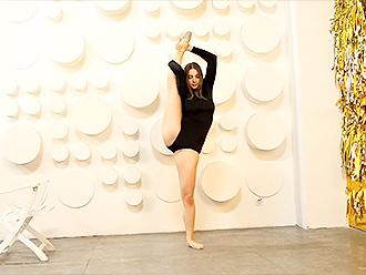 Sexy gymnast in tight black bodysuit