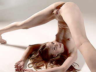 Flexible naked girl performs nude gymnastics on a hammock