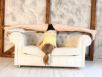 Redhead sexy gymnast does exercises in hot yoga video